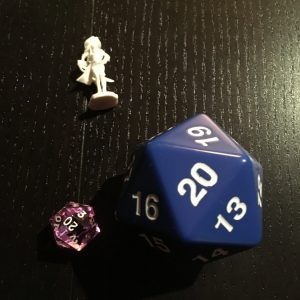 Big d20 with extra die and mini for scale